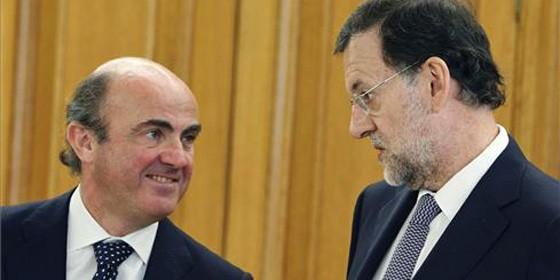 Mariano Rajoy y Luis de Guindos.