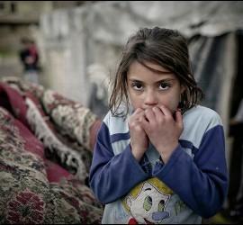Una niña siria en uno de los campos de refugiados de Líbano