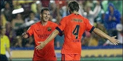 Messi y Rakitic.