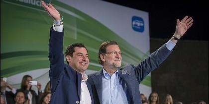 Juanma Moreno con Mariano Rajoy.