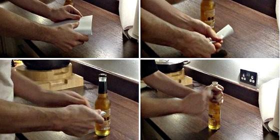 Cuatro pasos para abrir una botella de cerveza con un papel.