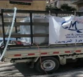 Camioneta de los maristas azules que suministra agua en Alepo