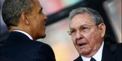 Barack Obama con Raúl Castro.