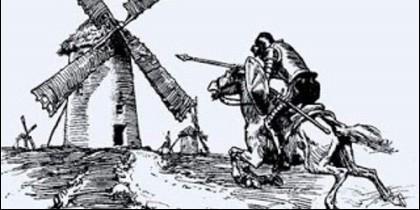Don Quijote ataca los molinos de viento en La Mancha.