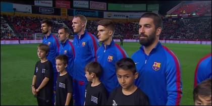 Futbolistas del Barça durante 'Els Segadors'.