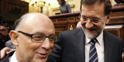 Cristonal Montoro con Mariano Rajoy.