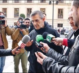 El padre Román, a su entrada al juicio