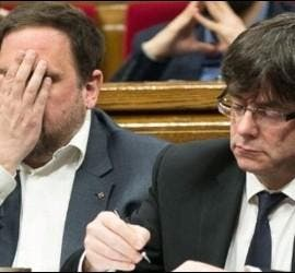 Oriol Junqueras (ERC) con Carles Puigdemont (PDCAT).