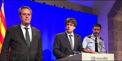 Joaquim Forn, Carles Puigdemont y  Josep Lluís Trapero.