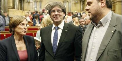 Puigdemont, Forcadell y Junqueras en el Parlament .