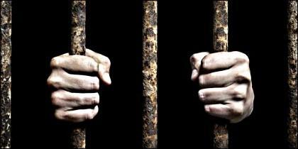 Prisión, preso, barrotes, condena, delito y Ley.