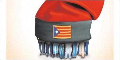 Catalanes bajo la estelada y la barretina.