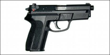 Pistola SIG SP 2009 con seguro de aleta en la corredera.