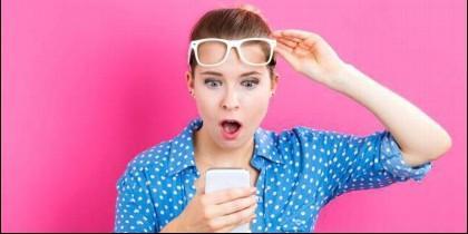 Teléfono móvil, factura, mensaje y estafas.