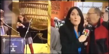 Doro informa a la reportera de TV que se enteró del premio de la Lotería en el vater.