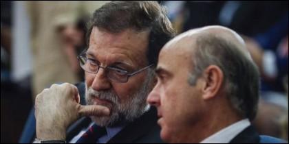 Mariano Rajoy con Luis de Guindos.