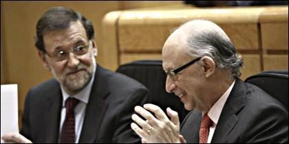 Mariano Rajoy y Cristobal Montoro (PP).