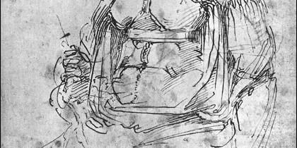 La  figura pequeña de pie, delante del abdomen, es la caricatura de Miguel Angel.