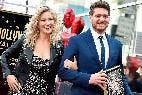Michael Bublé y su esposa  (People)