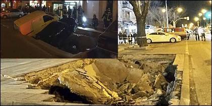 El socavón engulle dos coches en Madrid.