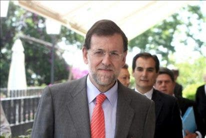"""Rajoy dice que el decreto revela la """"degradación"""" y el """"travestismo"""" de Zapatero"""