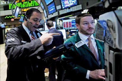 Wall Street baja el 0,21 por ciento en una jornada repleta de compras empresariales