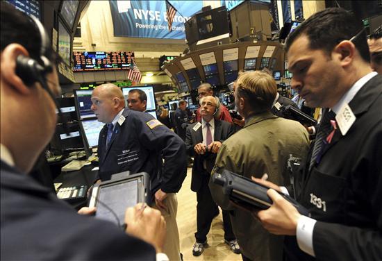 Wall Street recibe optimista el esperado estímulo de la Fed
