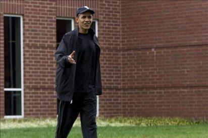 Obama juega al baloncesto para bajar los excesos del Día de Acción de Gracias