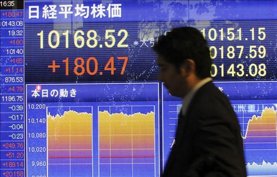 El índice Nikkei baja 11,16 puntos, 0,11 por ciento, hasta 10.156,07 puntos