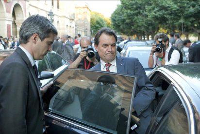 Zapatero traslada a Mas su apoyo ante la situación vivida en el Parlament