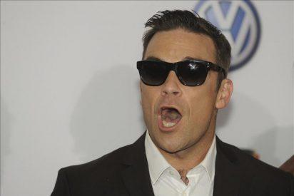 Take That suspende su concierto danés por una intoxicación de Robbie Williams