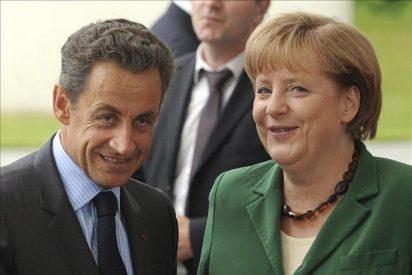 Sarkozy y Merkel pactaron una línea común para el rescate griego en consenso con el BCE