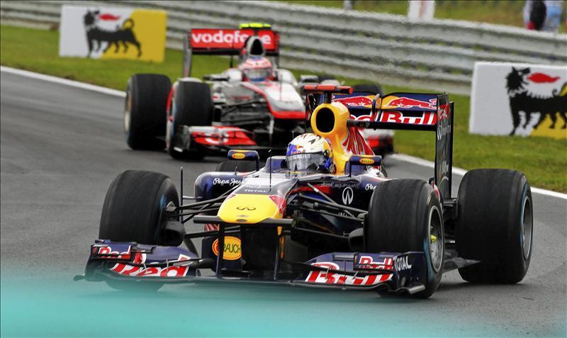 Button gana una carrera con lluvia en la que Alonso fue tercero