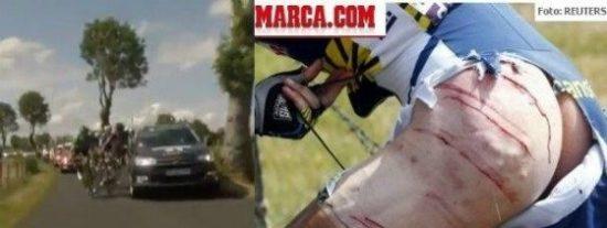Un coche de la televisión francesa arrolla a Hoogerland, que llega herido y semidesnudo a la meta y se derrumba en el podio