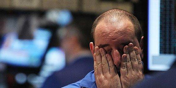 Standard & Poor's baja la nota de 10 entidades financieras españolas