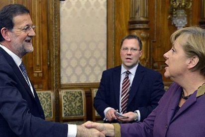 Rajoy está a la espera del visto bueno de Merkel para solicitar el rescate