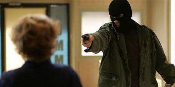 Detenidos dos atracadores de bancos que trataron de huir parapetados tras dos rehenes