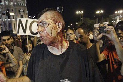 La 'barbacoa de chorizos' frente a la sede del PP en Madrid termina con 'tortas'