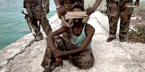 Los islamistas que meten en el mar a unos cristianos ¡para matarlos a ráfagas de AK-47!