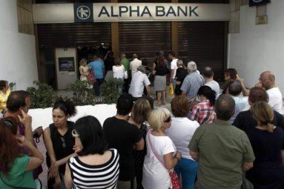 Reabren los bancos griegos después de 21 días de corralito