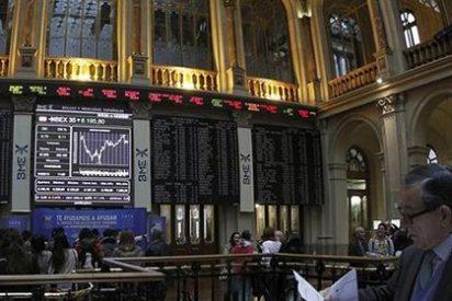 El Ibex 35 cae un 0,4% en la apertura con Abengoa rebotando un 21% en su primer día fuera del selectivo
