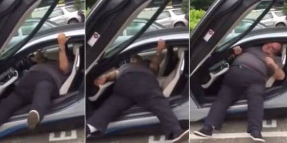 El hombre sobrado de pasta y peso que se atasca en su BMW i8
