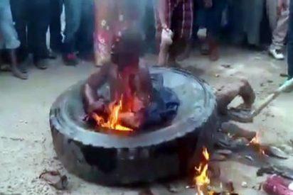 El resignado gay quemado vivo por una aullante y cruel horda musulmana