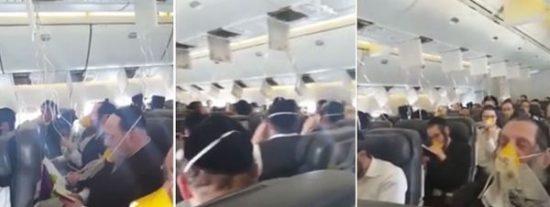 Los desesperados judíos que rezan con máscaras de oxígeno en un avión con problemas