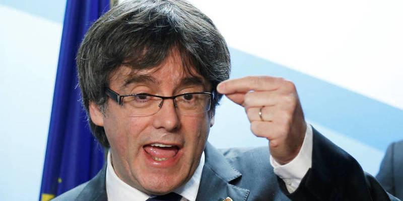 La jugada de Rajoy para obligar al tahúr de Puigdemont a volver y meterle entre rejas
