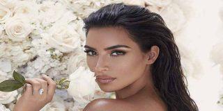 Kim Kardashian descansa sobre el paquete de Kanye West