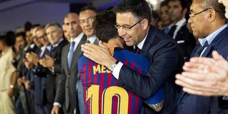 Josep María Bartomeu y Lionel Messi.