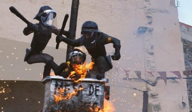 'Queman' un guardia civil, un policía nacional y un paracaidista en Gerona