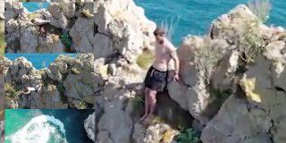 El momento en que el chaval salta al mar desde 70 metros de altura y se parte la espalda