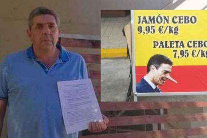 Denuncia al alcalde socialista de Jabugo por retirar el cartel de los jamones 'anti Pedro Sánchez'